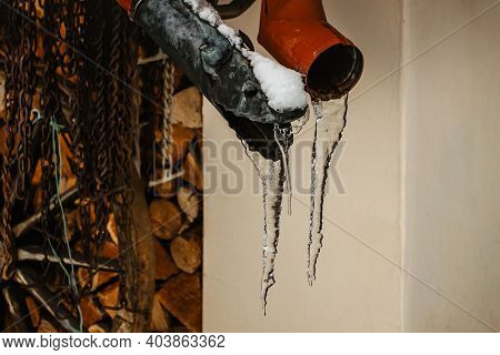 Close Up Of Hanging Icicles. Winter Background With Icicles. Sharp Icicles And Melted Snow Hanging F