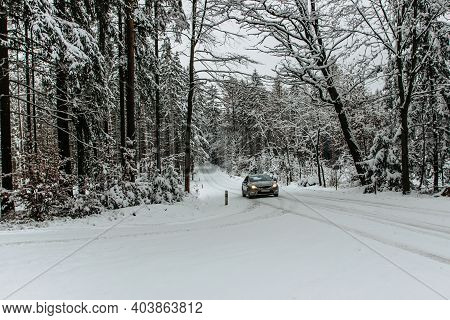 Car On A Dangerous Stretch Of Road Covered With Snow And Ice.snowy Road Through Forest.winter Panora