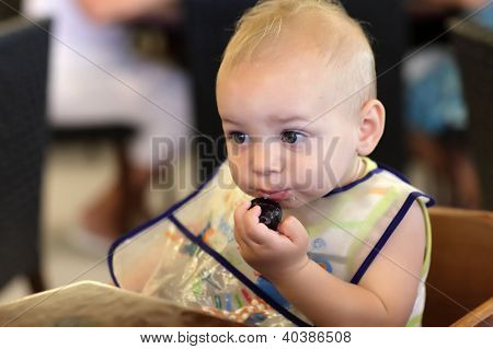 Baby With Plum
