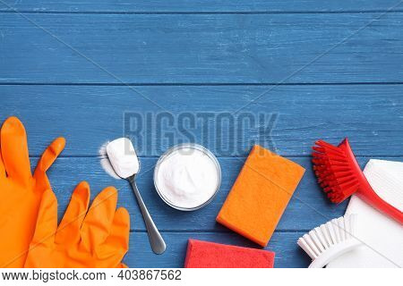 Flat Lay Composition With Baking Soda On Blue Wooden Table. Space For Text