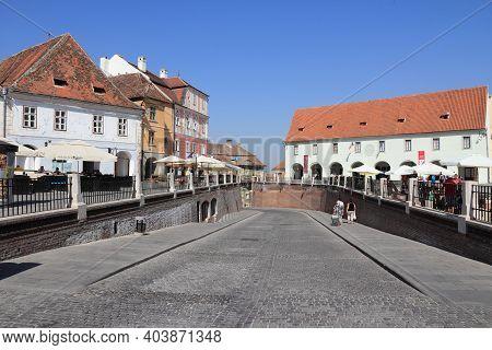 Sibiu, Romania - August 24, 2012: People Visit Old Town In Sibiu, Romania. Sibiu's Tourism Is Growin