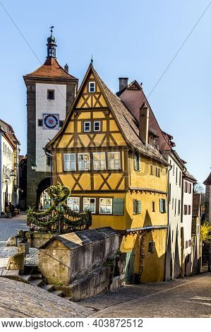 Old Half Timbered House In Rothenburg Ob Der Tauber, Germany. The Medieval Town Attracts Over 2 Mill