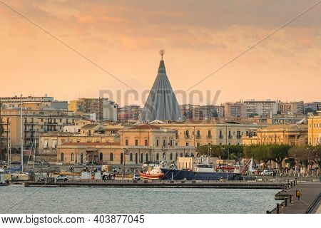 Sanctuary of Our Lady of Tears in Syracuse at sunset, Sicily, Italy. Cityscape of Siracusa in Sicilia