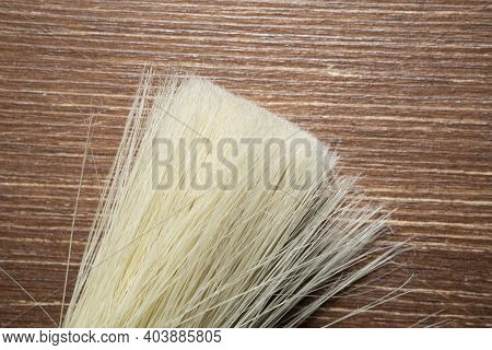 The Detail Of The Bristles Of A Brush On An Old Wooden Table