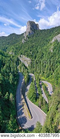 Serpentine Road In Summer Mountain, Curvy Road In Green Forest. The Bicaz Gorge Is A Canyon In The N