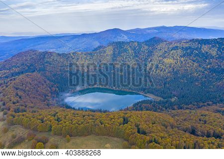 Forest Lake During Autumn Viewed From Above. Saint Anne Lake Is The Only One Crater Lake From Romani