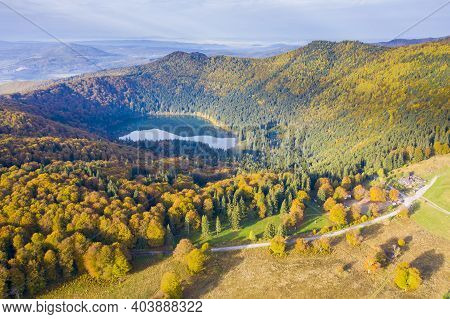 Aerial Landscape Of Autumn Mountain Lake. Saint Anne Lake Is The Only One Crater Lake From Romania,