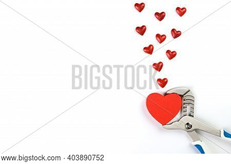 . Wrench With Hearts Isolated On Background. The Concept Of Your Favorite Profession And Valentines
