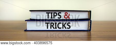 Tips And Tricks Symbol. Books With Words 'tips And Tricks'. Beautiful Wooden Table, White Background