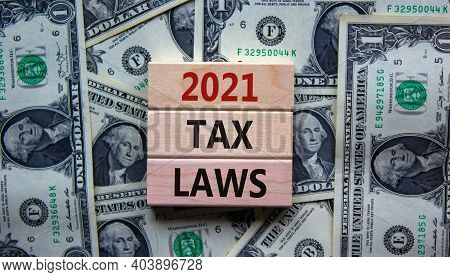 2021 Tax Laws Symbol. Concept Words '2021 Tax Laws' On Wooden Blocks On A Beautiful Background From