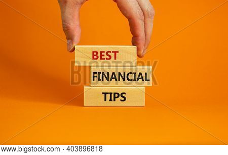 Best Financial Tips Symbol. Wooden Blocks With Words 'best Financial Tips'. Beautiful Orange Backgro
