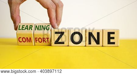 Comfort Or Learning Zone Symbol. Hand Turns Wooden Cubes And Changes Words 'comfort Zone' To 'learni