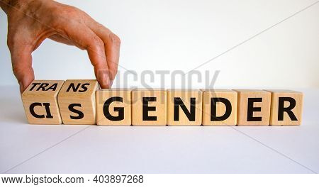 Transgender Or Cisgender Symbol. Male Hand Flips Wooden Cubes And Changes Word 'cisgender' To 'trans