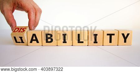 Liability Or Disability Symbol. Businessman Turns Cubes And Changes The Word 'liability' To 'disabil