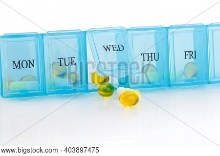 Pill Organizer With Variety Of Pills And Supplement. Weekly Pill Organizer Isolated On White Backgro