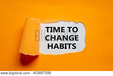 Time To Change Habits Symbol. The Text 'time To Change Habits' Appearing Behind Torn Orange Paper. B