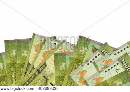 1000 Sri Lankan Rupees Bills Lies On Bottom Side Of Screen Isolated On White Background With Copy Sp
