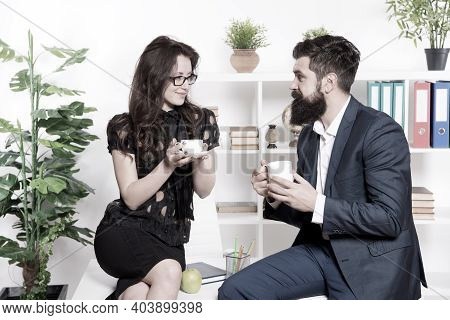 Man And Woman Pleasant Conversation During Coffee Break. Discussing Office Rumors. Ask For Recommend