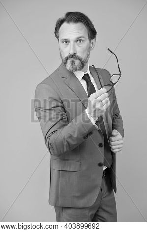 Serious Businessman. Education For Adults. Perplexedly Removes Glasses. Business Education. Self Edu