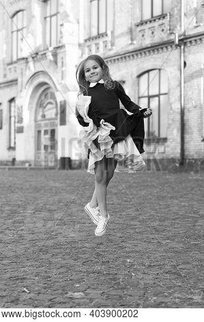 Express Yourself Through Movement. Dancing Girl Wear Uniform Outdoors. Energetic Child In Midair. Da