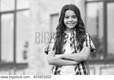 Confident And Delightful. Confident Child Keep Arms Crossed Outdoors. Confident Look Of Fashion Girl
