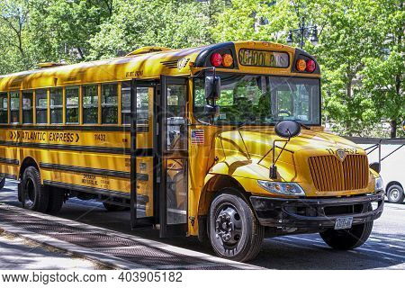 New York / New York / United States - April 14, 2011:american School Bus Stopped In Front Of The Cen
