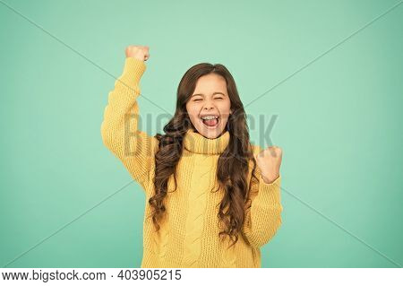 Adorable Smiling Girl Wear Yellow Sweater Turquoise Background. Positivity Concept. Good Vibes. Emot