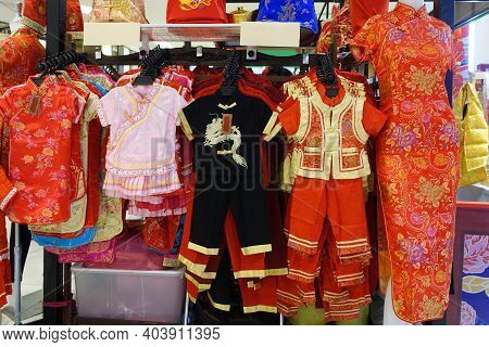 Auspicious Clothes To Celebrate Chinese New Year Hanging For Sale In A Community Place. Chinese New