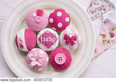 Pink baby shower cupcakes for a little girl