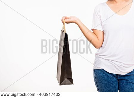 Closeup Female Holds In Hand With Black Clear Empty Blank Craft Paper Gift Bag, Women Hand Holding B