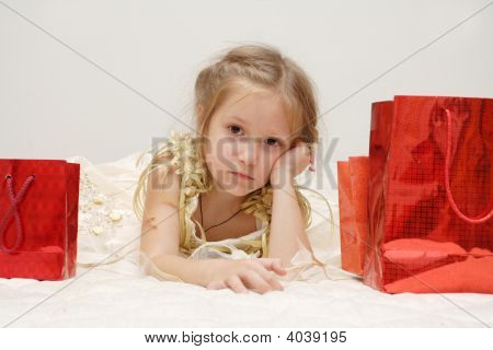 Sad Girl With Her Gifts