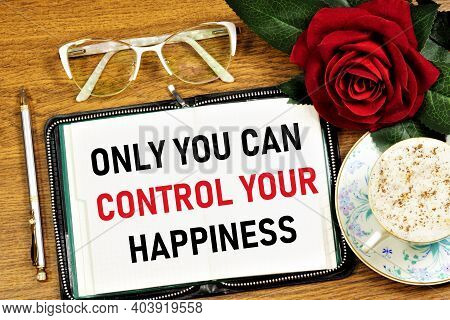 Only You Can Control Your Happiness. Text Inscription Of Inspiration In The Planning Notebook. Satis