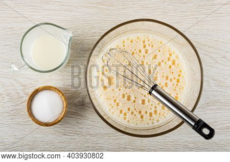 Pitcher With Milk, Salt In Bamboo Bowl, Whipped Eggs With Milk, Whisk In Glass Transparent Bowl On W