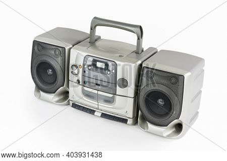 Old stereo boom box portable radio, cd, cassette tape player and recorder machine on white.