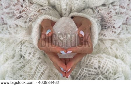 Womans Hands Holding The Natural Protection Crystal.