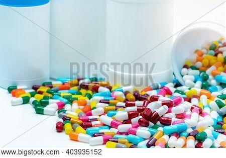 Heap Of Antibiotic Capsule With Plastic Bottle. Antibiotic Drug Resistance Concept. Antibiotic Drug