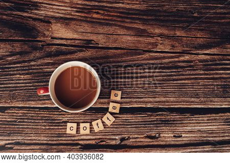 Coffee Cup And Wooden Letter Block Word