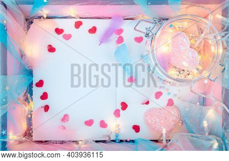 A Book, Feather, Heart Shape And Light Decorative In Box Present. Love, Valentine And Holiday Concep