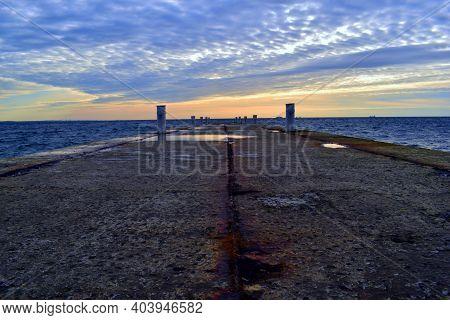 Concrete Pier, Sea View, Horizon, Sky In Clouds. Dream Of An Empty Concrete Pier Concept Of Rest, Va