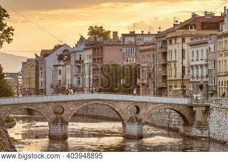 Sarajevo, BiH - August 28, 2019: Latin Bridge on Miljacka River at sunset in Sarajevo, Bosnia and Herzegovina