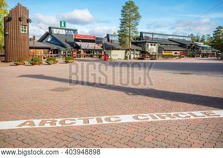Rovaniemi, Finland - September 18, 2019: Souvenirs shop and Arctic circle mark near Rovaniemi at autumn, Finland