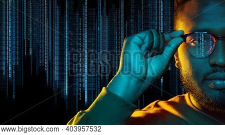 technology, cyberspace and programming concept - portrait of young african american man over binary code numbers on black background
