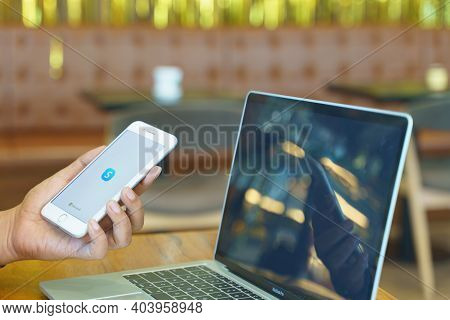 Chiang Mai, Thailand - Dec. 27,2020: Man Holding Apple Iphone With Skype Apps. Skype Is Part Of Micr