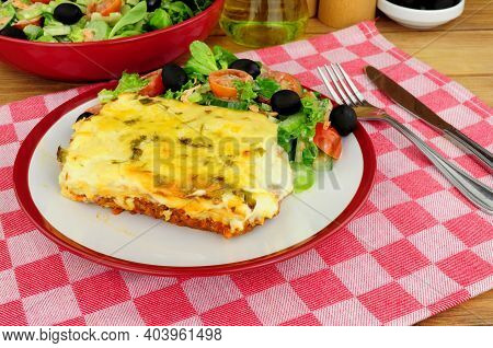 Slow Cooked Beef And Pork Ragu Lasagne Meal With Fresh Salad And Olives