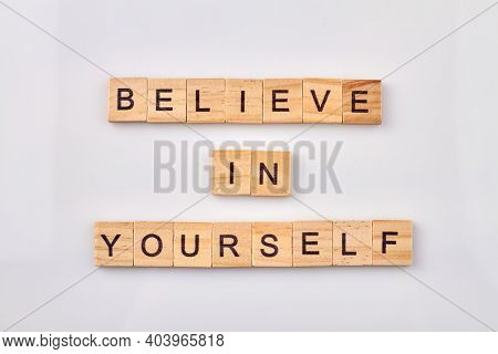 Words For Self-confidence And Assurance. Believe In Yourself. Wooden Cubes With Letters Is Making Wo