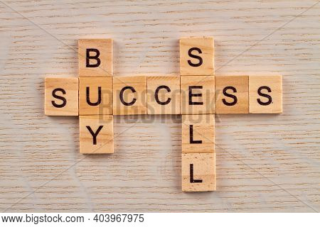 Basic Economy Terms. Buy And Sell For Success In Business. Top View Of Wooden Blocks On The Desk.
