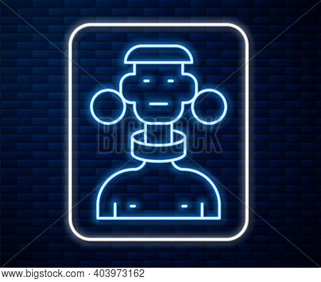 Glowing Neon Line African Tribe Male Icon Isolated On Brick Wall Background. Vector