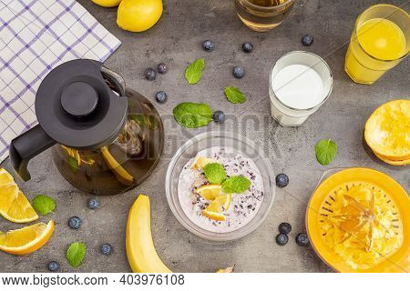 Healthy Breakfast With Fruits. Black Rice Pudding, Passion Fruit, Coconut And Orange, Top View. Tea,