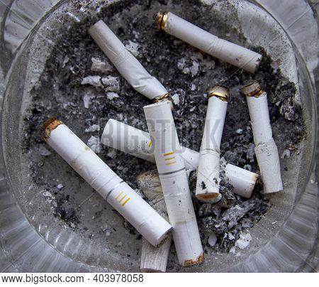 Ashtray Full Of Cigarette Butts. Close-up Photo