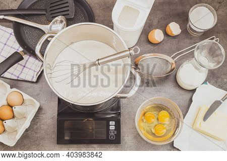 Preparation Of Homemade Pancakes. Prepared Ingredients For Cooking On The Kitchen Counter. Sweet Foo
